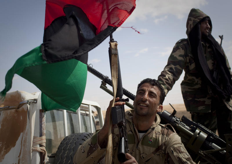 Libyan rebels take up position on a checkpoint on the frontline near Zwitina, the outskirts of the city of Ajdabiya, south of Benghazi, eastern Libya, Thursday, March 24, 2011. (AP Photo/Anja Niedringhaus)