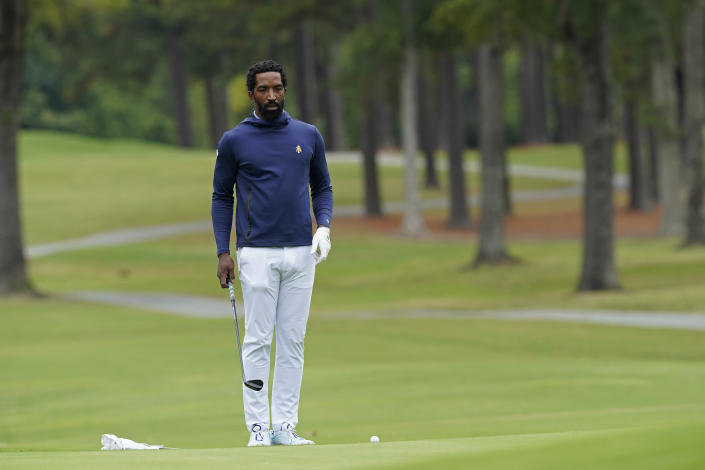 North Carolina A&T's J.R. Smith lines up his shot on the 17th green during the first round of the Phoenix Invitational golf tournament in Burlington, N.C., Monday, Oct. 11, 2021. Smith, who spent 16 years in the NBA made his college golfing debut in the tournament hosted by Elon. (AP Photo/Gerry Broome)