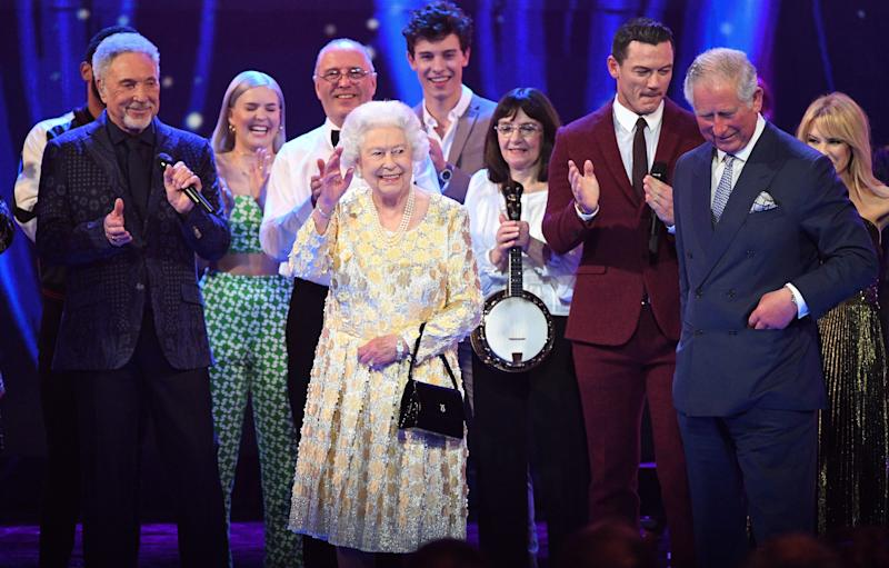 Britain's Prince Charles, Prince of Wales (R) and his mother Britain's Queen Elizabeth II join the performers on stage during The Queen's Birthday Party concert on the occassion of Her Majesty's 92nd birthday at the Royal Albert Hall in London on April 21, 2018. (Photo by Andrew Parsons / POOL / AFP) (Photo credit should read ANDREW PARSONS/AFP via Getty Images)