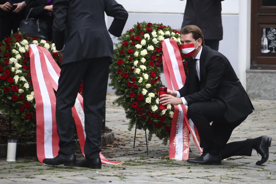 Austria Chancellor Sebastian Kurz, right, and President Alexander van der Bellen lay down a wreath in Vienna, Austria, Tuesday, Nov. 3, 2020. Police in the Austrian capital said several shots were fired shortly after 8 p.m. local time on Monday, Nov. 2, in a lively street in the city center of Vienna. Austria's top security official said authorities believe there were several gunmen involved and that a police operation was still ongoing. (AP Photo/Matthias Schrader)