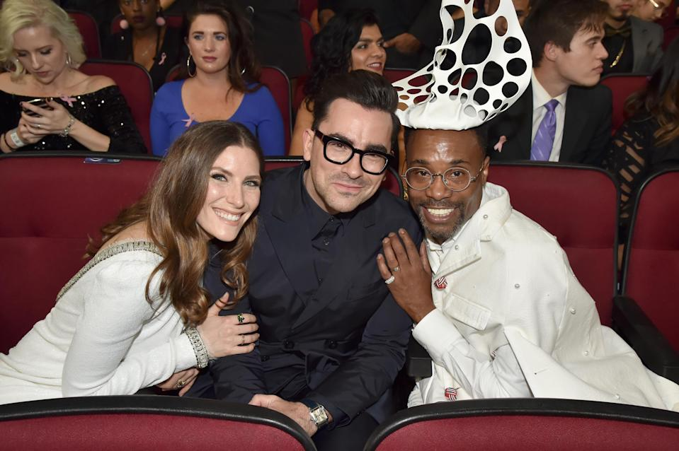 Dan Levy, center, and Billy Porter, right (seen with Sarah Levy at the 2019 American Music Awards) are among the talents being featured in a New York City Pride broadcast this year. (Photo: Jeff Kravitz/AMA2019/FilmMagic for dcp)