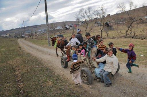 Romanian children, members of the Roma community, ride on a horse pulled cart back to their homes in Hetea village, 200 kms north of Bucharest, in March 2012. In this deprived village of central Romania, the number of children enrolled at the kindergarten went from 89 two years ago to 174 today thanks to a program developed by NGO Ovidiu Rom in partnership with the local community