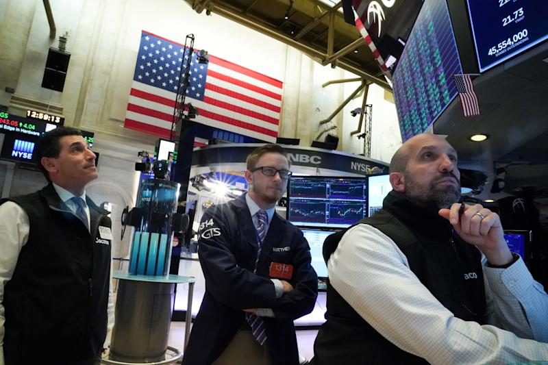 Traders work at the New York Stock Exchange (NYSE) in New York, U.S., February 4, 2020. REUTERS/Bryan R Smith