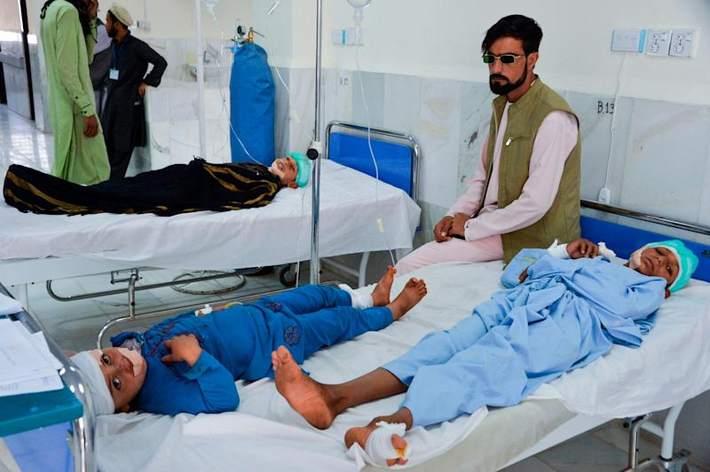 At least three people were killed and about 20 children wounded when a Taliban truck bomb detonated on Oct. 16 near a rural police station and partially destroyed a nearby religious school, Afghan officials said. Children are seen receiving medical treatment in a hospital. (Photo: NOORULLAH SHIRZADA via Getty Images)
