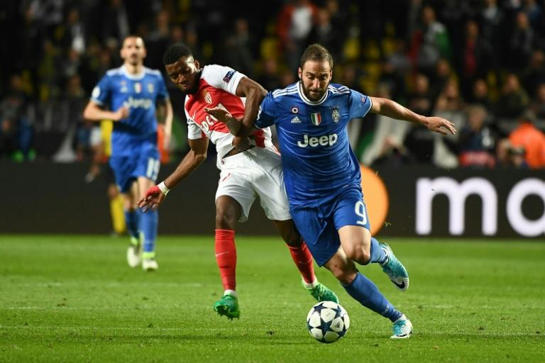 "Gonzalo Higuain (R) urged Juventus teammates not to get carried away after their win over Monaco in the Champions League semi-final first leg, ""we have not won anything yet"""
