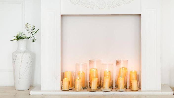 filled in fireplace with candles