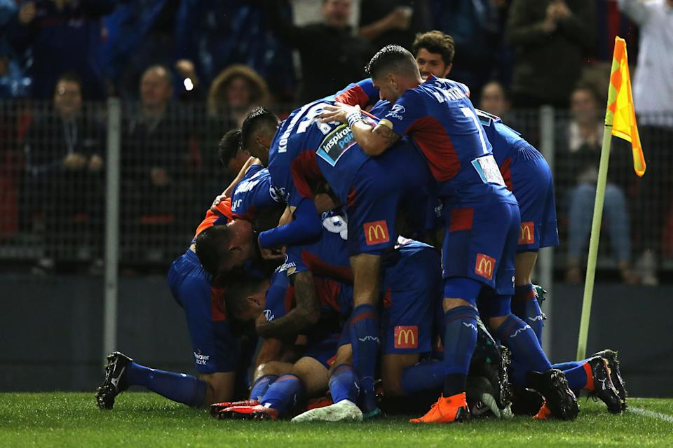 Newcastle Jets players celebrate Riley McGree's scorpion kick goal in their A-League semifinal against Melbourne City. (Getty)