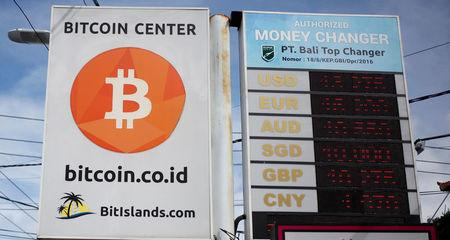 A Bitcoin sign is seen in Kuta on the resort island of Bali