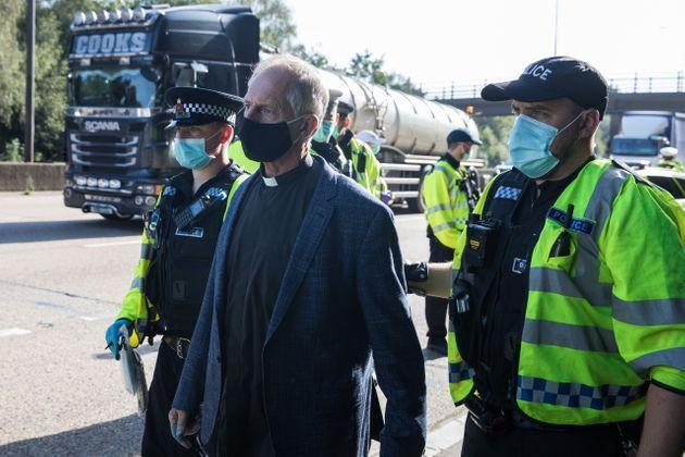 <strong>Insulate Britain climate activist Reverend Tim Hewes is arrested by Surrey Police.</strong> (Photo: Mark Kerrison via Getty Images)