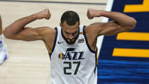 Utah Jazz center Rudy Gobert flexes his muscles after scoring against Los Angeles Clippers Nicolas Batum during the second half of an NBA basketball game Friday, Jan. 1, 2021, in Salt Lake City. (AP Photo/Rick Bowmer)