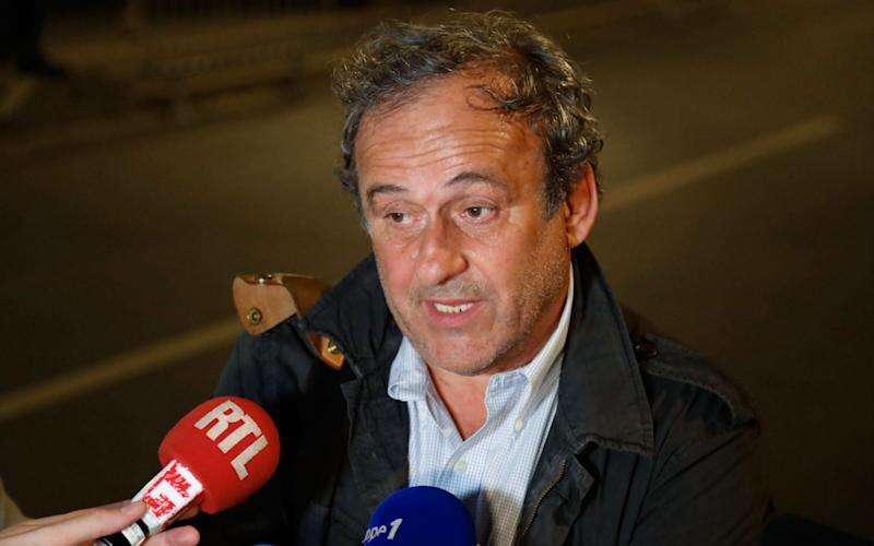 Ex-UEFA chief Michel Platini talks to the media before leaving the Central Office for Combating Corruption and Financial and Tax Crimes - AFP