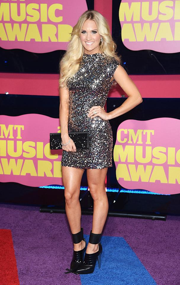 "<p class=""MsoNormal"">Carrie Underwood dazzled the crowd in a sparkling minidress, which she paired with a Swarovski clutch and sexy black pumps. </p>"
