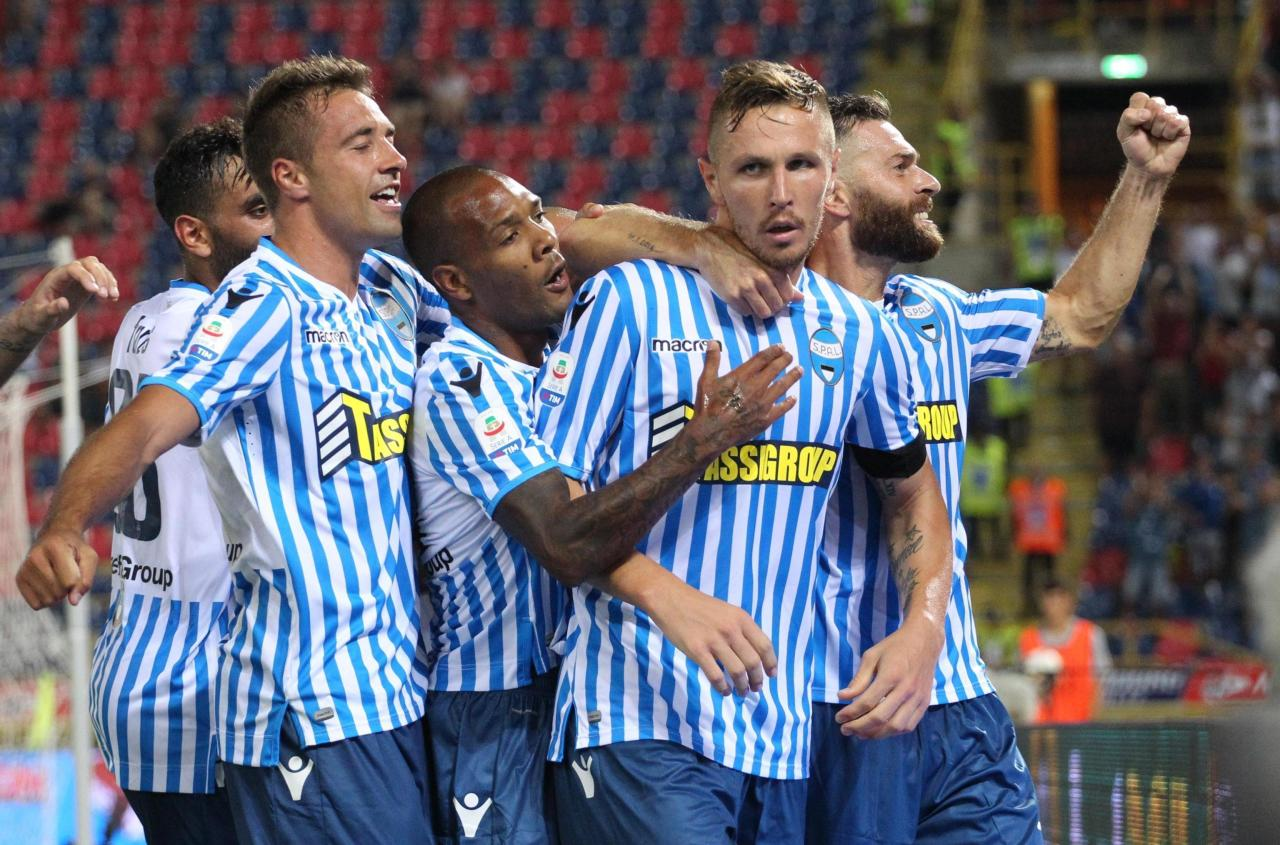 FILE - This Sunday, Aug. 19, 2018 file photo shows Spal's Jasmin Kurtic, 2nd left, celebrating with teammates after scoring during the Serie A soccer match between Bologna and Spal, at the Dall'ara Stadium in Bologna, Italy. Through four rounds, the Ferrara-based team sits second in the standings, behind only seven-time defending champion Juventus and ahead of Napoli, last year's runner-up, on goal difference. (Giorgio Benvenuti/ANSA via AP, )