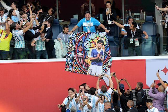 <p>Diego Maradona holds a banner of himself in the stands before the FIFA World Cup Group D match at Saint Petersburg Stadium. (Photo by Owen Humphreys/PA Images via Getty Images) </p>