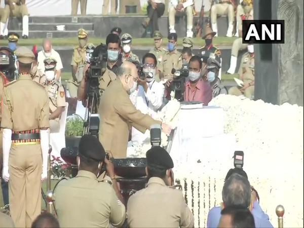 Union Home Minister Amit Shah paying tribute to the police personnel who lost their lives in the line of duty. (Photo/ANI)