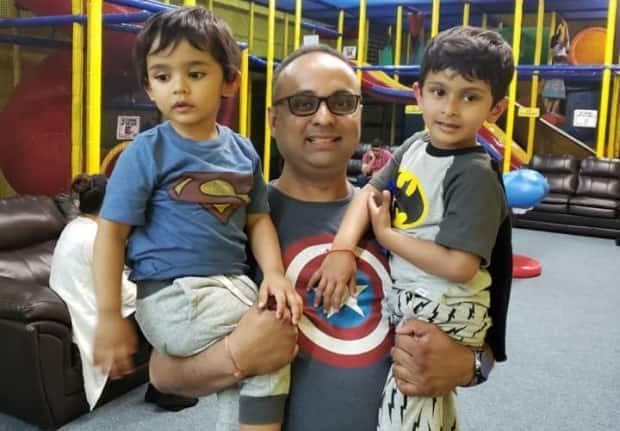 Avi Chaudhury poses with his two sons, both of whom are on the autism spectrum.