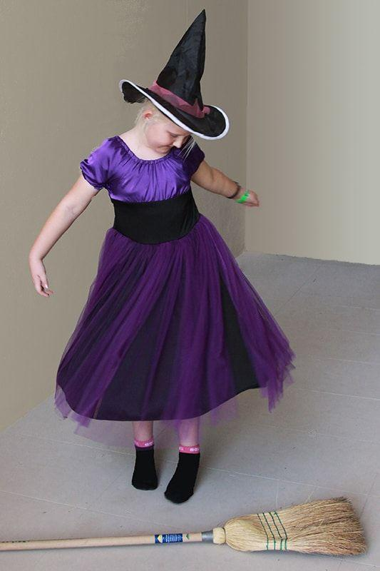 """<p>This spooky dress is made from a pattern and is best suited for beginner-to-intermediate seamstresses. </p><p><strong>Get the tutorial at <a href=""""https://threadistry.com/blog/diy-witch-costume-girl"""" rel=""""nofollow noopener"""" target=""""_blank"""" data-ylk=""""slk:Threadistry"""" class=""""link rapid-noclick-resp"""">Threadistry</a>.</strong></p><p><a class=""""link rapid-noclick-resp"""" href=""""https://www.amazon.com/Craft-Party-fabric-wedding-decoration/dp/B01N14CF29/ref=sr_1_4?tag=syn-yahoo-20&ascsubtag=%5Bartid%7C10050.g.28304812%5Bsrc%7Cyahoo-us"""" rel=""""nofollow noopener"""" target=""""_blank"""" data-ylk=""""slk:SHOP PURPLE TULLE"""">SHOP PURPLE TULLE</a></p>"""