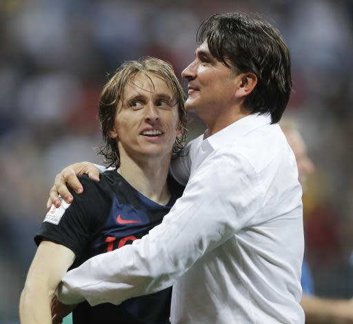 Croatia head coach Zlatko Dalic, right, celebrates with Luka Modric after his team advanced to the final during the semifinal match between Croatia and England at the 2018 soccer World Cup in the Luzhniki Stadium in Moscow, Russia, Wednesday, July 11, 2018. (AP Photo/Frank Augstein)