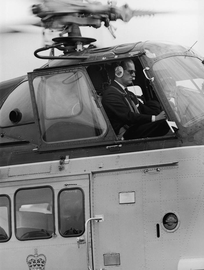 """Prince Philip at the controls of the royal helicopter, July 28, 1965.<span class=""""copyright"""">George W. Hales—Fox Photos/Hulton Archive/Getty Images</span>"""