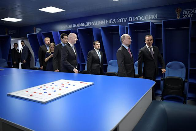 Russian President Vladimir Putin (2nd R) and FIFA President Gianni Infantino (4th R) visit a dressing room at the Fisht Stadium, which will host matches of the 2018 FIFA World Cup in Sochi, Russia May 3, 2018. Sputnik/Aleksey Nikolskyi/Kremlin via REUTERS ATTENTION EDITORS - THIS IMAGE WAS PROVIDED BY A THIRD PARTY.
