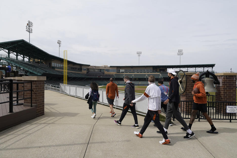 The Texas basketball team walks around the concourse at Victory Field at the NCAA college basketball tournament, Wednesday, March 17, 2021, in Indianapolis. (AP Photo/Darron Cummings)
