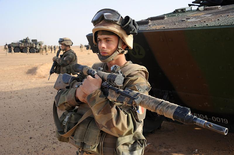 A French army sniper stands next to an armored vehicle outside Bourem, northern Mali, Sunday, Feb. 17, 2013. Mali's military detained eight Arab men last week in Timbuktu, raising fears of further reprisals against the region's Arab minority whose members are accused of having supported the al-Qaida-linked groups which overran northern Mali last year. (AP Photo /Pascal Guyot, Pool)