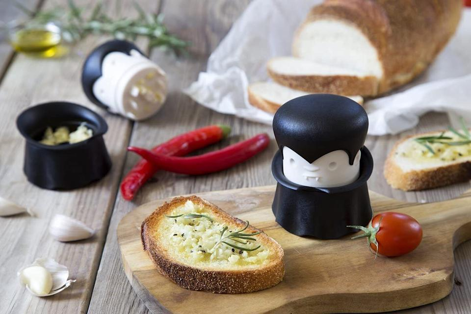 """Not only will this tool inspired by Dracula make you smile, it will also prevent your fingers from smelling like garlic all day. You can also use it to chop nuts, fruits and veggies.<br /><br /><strong>Promising review:</strong>""""I purchased this as a gift for my friend who is a fantastic cook — she uses fresh ingredients almost exclusively — but pressing fresh garlic is a task usually delegated. No longer — Gracula is there for her<strong>. She uses him nearly every time she needs garlic (which is basically daily) and months later still makes a point of saying how much she enjoys the gift.</strong>I'm pretty sure she likes it better than other gifts I've gotten her which were more expensive/thought out, and I'm fairly certain it's what took me from 'good friend' to 'best friend,' but it be that way sometimes. Anyway, definitely recommended for people who cook with garlic and have a sense of humor."""" —<a href=""""https://amzn.to/3sKgeys"""" target=""""_blank"""" rel=""""noopener noreferrer"""">L<br /></a><br /><strong>Get it from Amazon for<a href=""""https://amzn.to/32HC8b7"""" target=""""_blank"""" rel=""""noopener noreferrer"""">$19</a>.</strong>"""