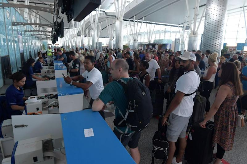 British tourists flying with Thomas Cook queue at the Enfidha International Airport in Tunisia on Sept. 23