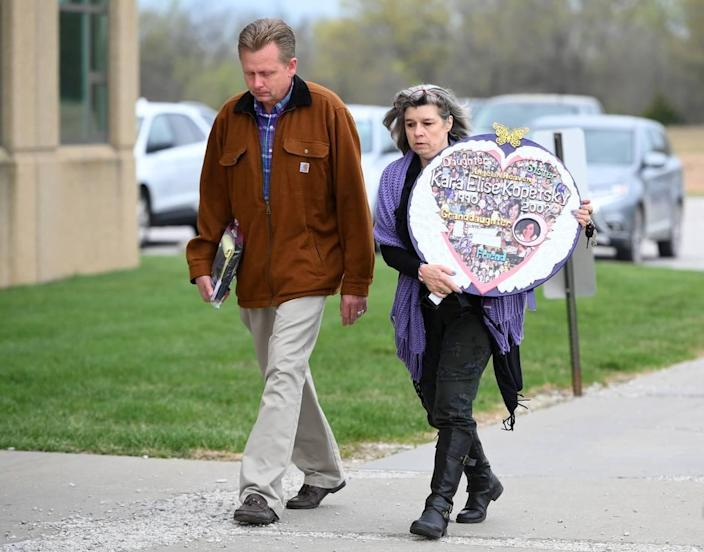 Kara Kopetsky's mother, Rhonda Beckford and step-father Jim Beckford, arrive at the Cass County Justice Center Friday, April 16, 2021, for the sentencing of Kylr Yust. Yust was found guilty by a jury Thursday of killing Kopetsky and Jessica Runions.
