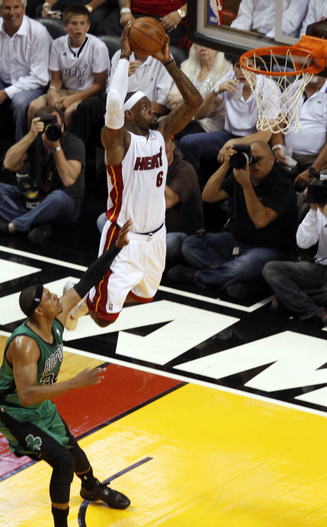 Miami Heat's LeBron James (6) dunks the ball over Boston Celtic's Paul Pierce during the first half of Game 1 in their NBA basketball Eastern Conference finals playoffs series, Monday May, 28, 2012, in Miami. (AP Photo/Wilfredo Lee)