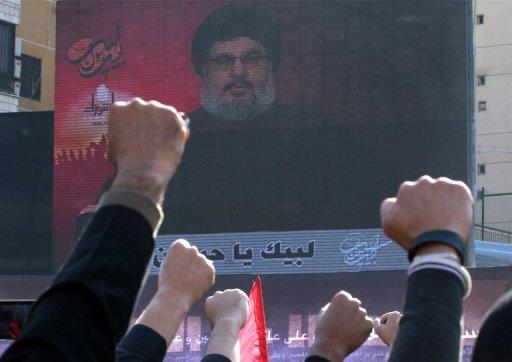 File picture shows Shiite Muslims listening to a screened speech by Hassan Nasrallah, the head of Shiite Hezbollah movement, in the Lebanese capital Beirut. Hezbollah came under increasing pressure over accusations it is backing regime troops in Syria, as a rebel leader warned of the risk of sparking a sectarian war