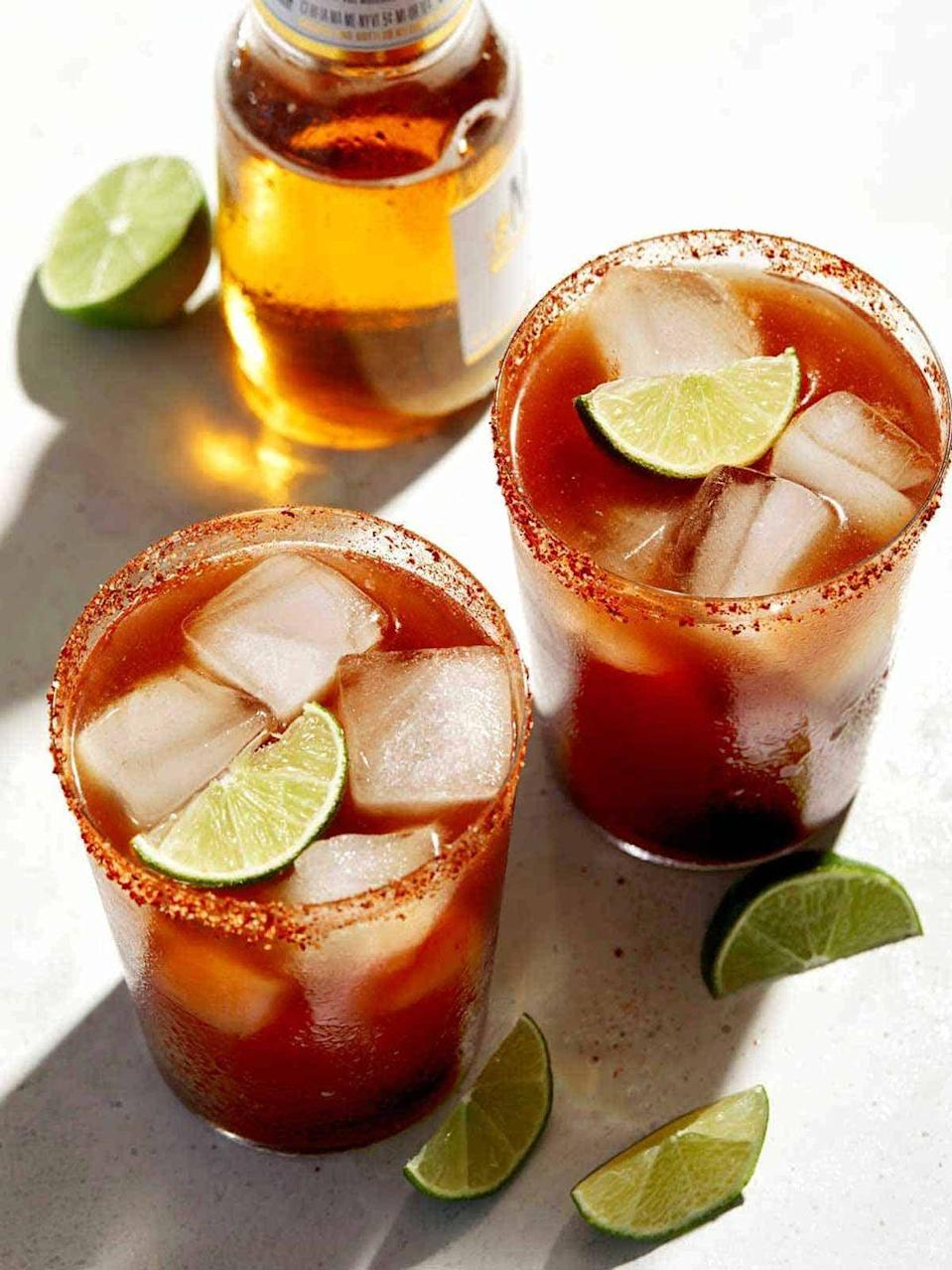 """<p>If you're more of a beer drinker, you'll love this tomato-based drink that uses beer instead of hard alcohol. To give it a special presentation, rim the glasses with a chile-lime seasoning such as <a href=""""https://www.thepioneerwoman.com/food-cooking/cooking-tips-tutorials/a35024143/tajin-seasoning/"""" rel=""""nofollow noopener"""" target=""""_blank"""" data-ylk=""""slk:Tajín"""" class=""""link rapid-noclick-resp"""">Tajín</a>.</p><p><strong>Get the recipe at <a href=""""https://www.spoonforkbacon.com/spicy-michelada/#wprm-recipe-container-18163"""" rel=""""nofollow noopener"""" target=""""_blank"""" data-ylk=""""slk:Spoon Fork Bacon"""" class=""""link rapid-noclick-resp"""">Spoon Fork Bacon</a>.</strong></p><p><a class=""""link rapid-noclick-resp"""" href=""""https://go.redirectingat.com?id=74968X1596630&url=https%3A%2F%2Fwww.walmart.com%2Fsearch%2F%3Fquery%3Dbottle%2Bopener&sref=https%3A%2F%2Fwww.thepioneerwoman.com%2Ffood-cooking%2Fmeals-menus%2Fg36432840%2Ffourth-of-july-drinks%2F"""" rel=""""nofollow noopener"""" target=""""_blank"""" data-ylk=""""slk:SHOP BOTTLE OPENERS"""">SHOP BOTTLE OPENERS</a></p>"""