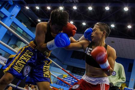 Huang Wensi fights in her match against Thailand's Jarusiri Rongmuang for the Asia Female Continental Super Flyweight Championship gold belt in Taipei, Taiwan, September 26, 2018. REUTERS/Yue Wu