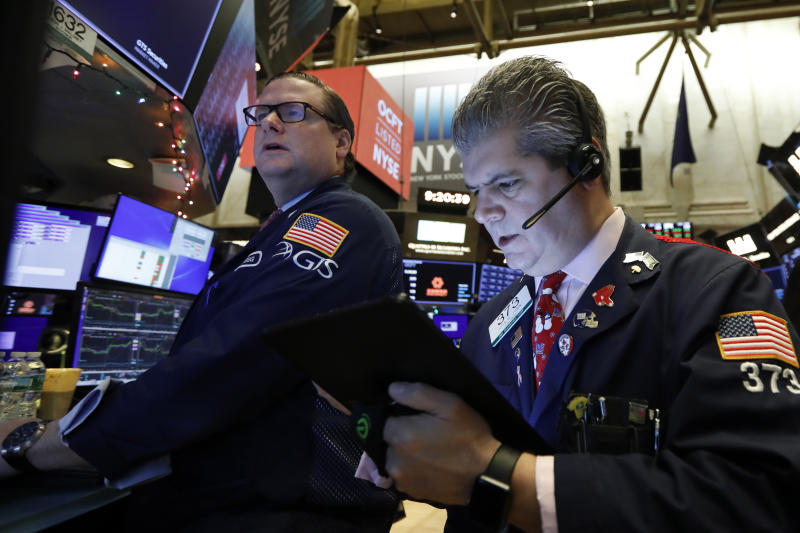 FILE - In this Dec. 13, 2019, file photo specialist Gregg Maloney, left, and trader John Panin work on the floor of the New York Stock Exchange. The U.S. stock market opens at 9:30 a.m. EST on Thursday, Dec. 26. (AP Photo/Richard Drew, File)