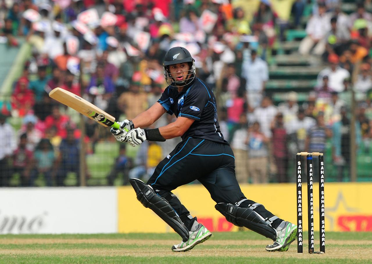 New Zealand batsman Ross Taylor plays a shot during the third One-Day International (ODI) cricket match between Bangladesh and New Zealand at Khan Jahan Ali Stadium in Fatullah, on the outskirts of Dhaka on November 3, 2013.   AFP PHOTO/ Munir uz ZAMAN        (Photo credit should read MUNIR UZ ZAMAN/AFP/Getty Images)