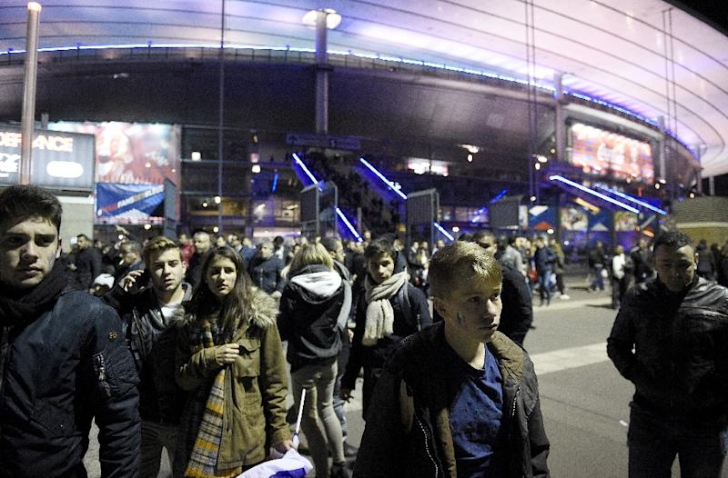 Football fans leave the Stade de France stadium following the friendly football match between France and Germany in Saint-Denis, north of Paris, on November 13, 2015 (AFP Photo/Franck Fife)
