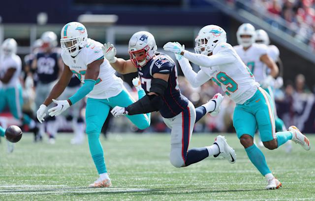 <p>Rob Gronkowski #87 of the New England Patriots is unable to catch a pass as he is defended by T.J. McDonald #22 and Minkah Fitzpatrick #29 of the Miami Dolphins during the first half at Gillette Stadium on September 30, 2018 in Foxborough, Massachusetts. (Photo by Maddie Meyer/Getty Images) </p>