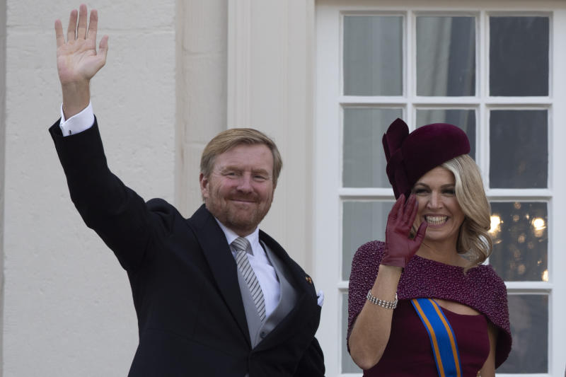 FILE - In this Tuesday, Sept. 17, 2019 file photo, Dutch King Willem-Alexander and Queen Maxima wave from the balcony of royal palace Noordeinde in The Hague, Netherlands. As the British royal family wrestles with the future roles of Prince Harry and his wife Meghan, it could look to Europe for examples of how princes and princesses have tried to carve out careers away from the pomp and ceremony of their families' traditional duties. King Willem-Alexander has a full-time job as his country's monarch but he still finds time to fly KLM passenger jets to rack up enough hours in the cockpit to keep his pilot's license. (AP Photo/Peter Dejong, File)