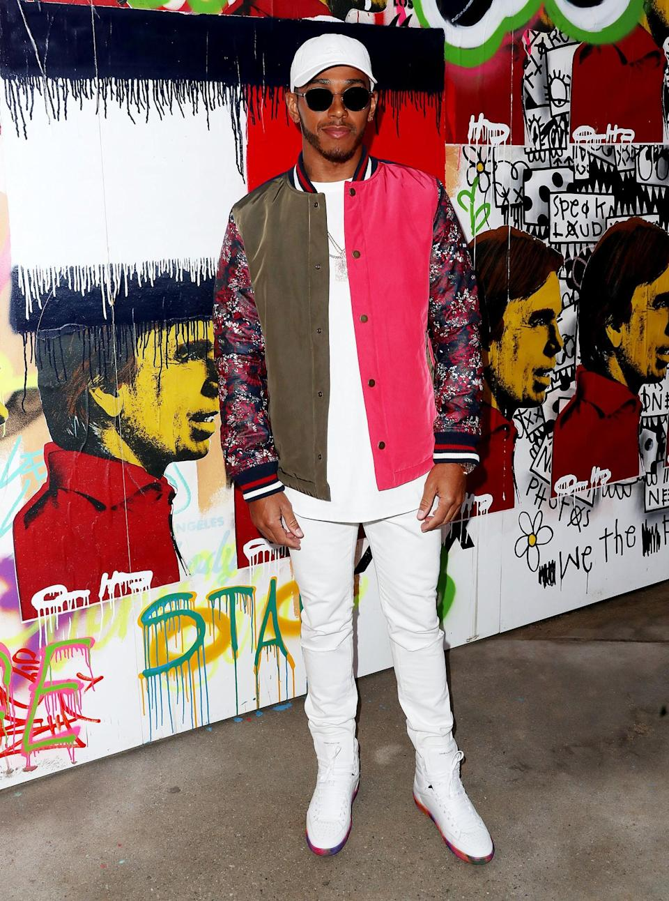 <p>Lewis Hamilton was in a striking white look and printed bomber jacket. <i>[Photo: Getty]</i> </p>