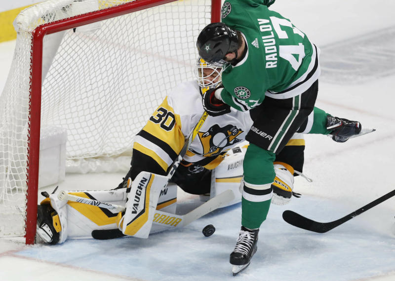 Pittsburgh Penguins goaltender Matt Murray (30) stops a shot by Dallas Stars right wing Alexander Radulov (47) during the third period of an NHL hockey game in Dallas, Saturday, March 23, 2019. (AP Photo/LM Otero)