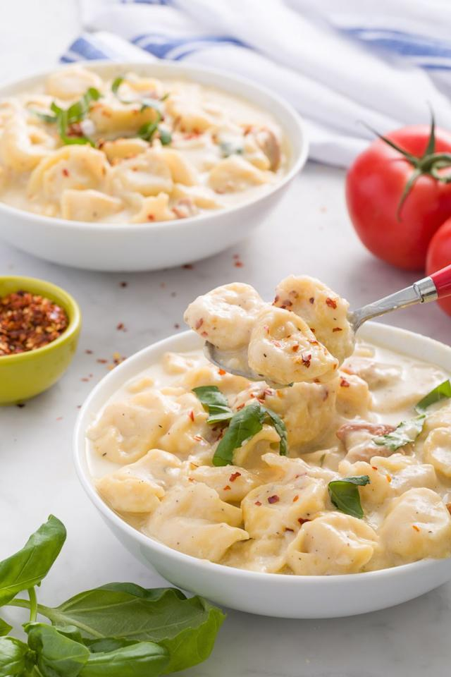 "<p>There is no such thing as too creamy or too cheesy. </p><p>Get the recipe from <a href=""https://www.delish.com/cooking/recipe-ideas/recipes/a44743/cheesy-chicken-alfredo-soup-recipe/"" target=""_blank"">Delish</a>.</p>"