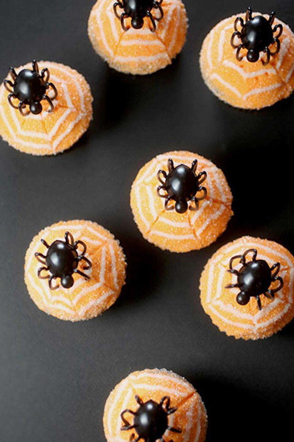 """<p>Just frost basic chocolate cupcakes with orange buttercream, then pipe on three circles of white frosting before dragging a toothpick through them to create a """"web."""" A plastic spider tops off this creepy treat!</p><p><strong>Get the recipe at </strong><strong><a href=""""http://www.bakerella.com/quick-and-easy-creepy-cupcakes/#comment-403156"""" rel=""""nofollow noopener"""" target=""""_blank"""" data-ylk=""""slk:Bakerella"""" class=""""link rapid-noclick-resp"""">Bakerella</a>.</strong></p><p><strong><a class=""""link rapid-noclick-resp"""" href=""""https://www.amazon.com/Wilton-Non-Stick-Muffin-Cupcake-Baking/dp/B00KIFBI1C/?tag=syn-yahoo-20&ascsubtag=%5Bartid%7C10050.g.1366%5Bsrc%7Cyahoo-us"""" rel=""""nofollow noopener"""" target=""""_blank"""" data-ylk=""""slk:SHOP CUPCAKE TINS"""">SHOP CUPCAKE TINS</a></strong></p>"""