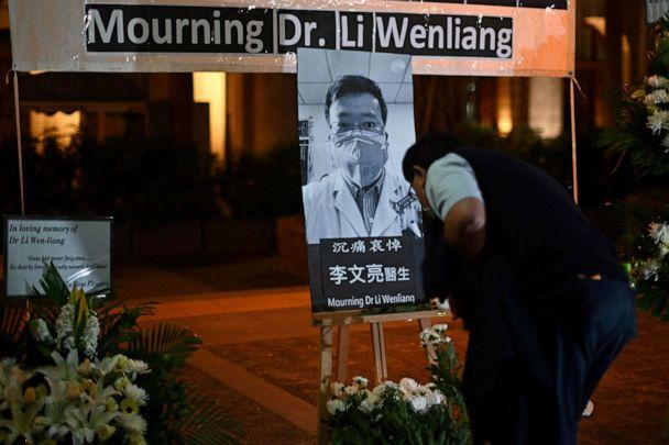 PHOTO: People attend a vigil in Hong Kong, Feb. 7, 2020, for novel coronavirus whistleblowing doctor Li Wenliang, who died in Wuhan after contracting the virus while treating a patient. (Anthony Wallace/AFP via Getty Images, FILE)