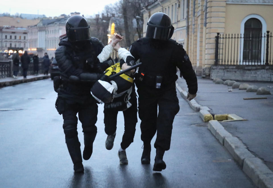 Police detain a man during a protest in support of jailed opposition leader Alexei Navalny in St. Petersburg, Russia, Wednesday, April 21, 2021. A human rights group that monitors political repression said at least 400 people were arrested across the country in connection with the protests. Many were seized before protests even began, including two top Navalny associates in Moscow. (AP Photo/Dmitri Lovetsky)