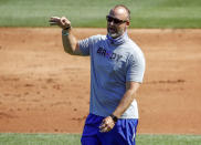 FILE - In this Friday, July 3, 2020, file photo, Chicago Cubs manager David Ross gestures during baseball practice at Wrigley Field in Chicago. Ross was already stepping into some big shoes when he agreed to replace Joe Maddon as manager of the Cubs. Then the coronavirus pandemic hit. Now Ross is a first-year skipper trying to guide his team through a brand new experience full of testing and protocols and an unforgiving 60-game season. How well he navigates the unprecedented situation is an important slice of the Cubs' hopes for returning to the playoffs. (AP Photo/Kamil Krzaczynski, File)