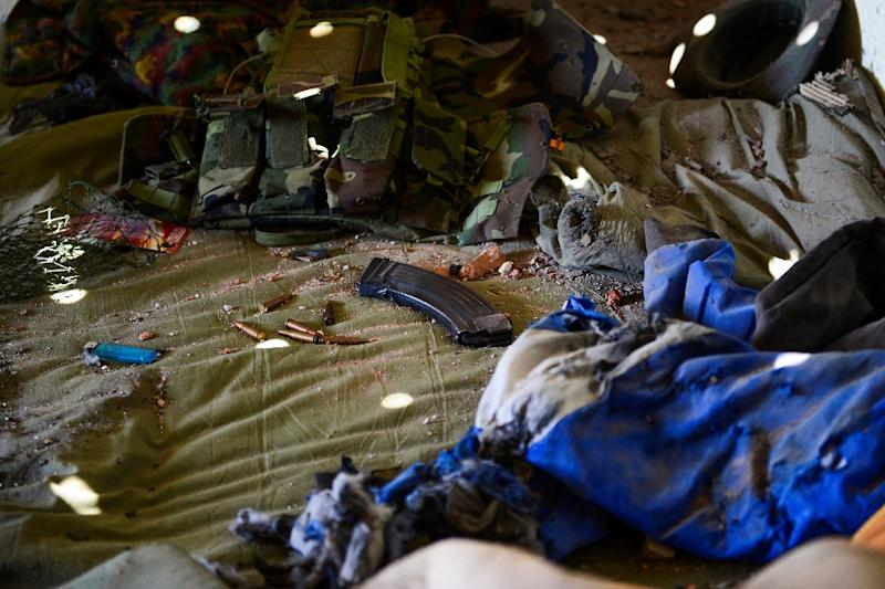 Ammunition is left on a bed inside an army-linked militia post in Muse a day after the clashes