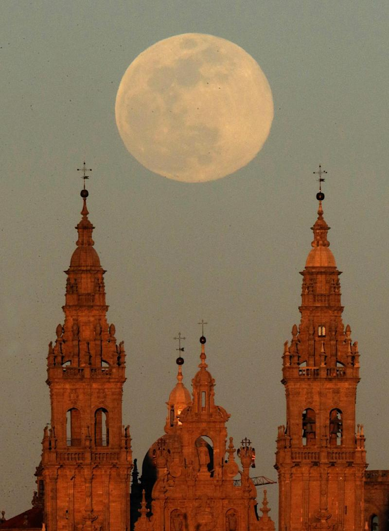 A view of the supermoon over the Santiago de Compostela cathedral in Galicia, Spain (EPA)