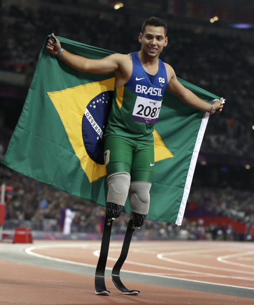 Brazil's Alan Fonteles Cardoso Oliveira celebrates after winning the men's 200m T44 final at the 2012 Paralympics, Sunday, Sept. 2, 2012, in London. (AP Photo/Kirsty Wigglesworth)
