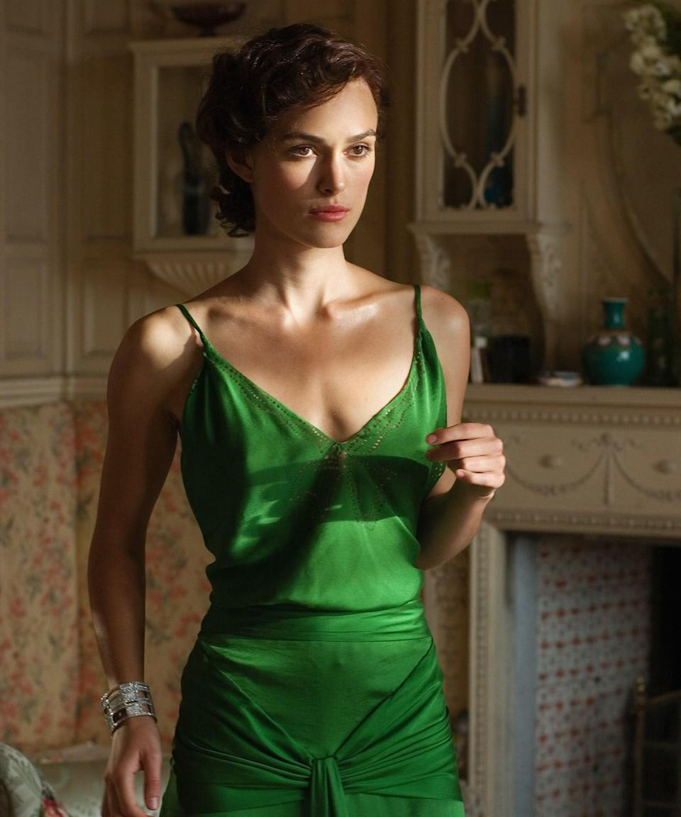 """<h2><em>Atonement (2007)</em></h2><br>We've been thinking about this dress a lot, or maybe, we never really <em>stopped</em> thinking about it at all. Designed by Jacqueline Durran, <a href=""""https://www.refinery29.com/en-us/2020/01/9295800/green-dress-gown-fashion-trend-history"""" rel=""""nofollow noopener"""" target=""""_blank"""" data-ylk=""""slk:the green dress"""" class=""""link rapid-noclick-resp"""">the green dress</a> worn by Keira Knightly's character Cecilia Tallis in Ian McEwan's <em>Atonement</em> is a wonder to this day, 13 years after it won Durran an Oscar for Best Costume Design. Slinky, sensual, and most of all, eye-catching, if you're looking for a flick to stir up some emotion about fashion (among other things), this is the one for you. <span class=""""copyright"""">Photo: Focus/Kobal/Shutterstock.</span>"""