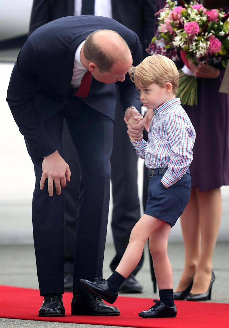 Prince William with Prince George (Jane Barlow/PA)